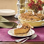 Pumpkin Pie Spectacular | MyRecipes.com -- a gorgeous pie for your holiday table, made with a crushed ginger snap crust, filled with a smooth and silky pumpkin spice filling & topped with a pecan streusel