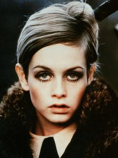 Twiggy EYEs with double lashes (top and bottom) mascara, light blush below the cheek bones and soft lip hues. A touch of dark gray shadow......and WoW!