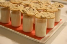 Milk shots and cookies.  what a cute idea for the reception!