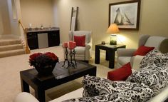 We love the color pops of red in this basement design from Great Traditions Homes
