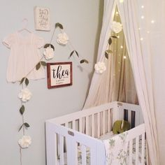 """Natural / Neutral / Simple """"Themed"""" Nursery     Dreamy - Boho baby - Bohemian - Sweet - Vintage Dress - Fairy Lights - Flower Garland - Princess Canopy - Numero 74 - Babyletto Origami Mini Crib - IKEA fabric - Succulent Wood Shop - Wood Signs - Thailand Green Elephant - Green & White Nursery - Thea Louise - She is clothed with strength and dignity"""