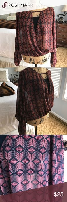 Olivaceous Blouse Sheer, bat-winged, diamond print blouse in burgundy and black. Open in front and probably requires bandeau (like the one in the first pic). Olivaceous Tops Blouses