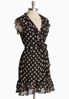 I love the delicate ruffles paired with big polka dots on this wrap dress.