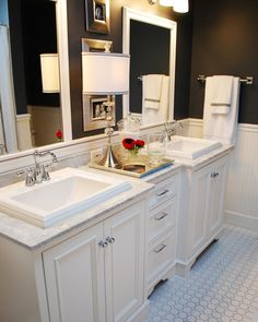 I love the dark charcoal walls with all the bright white.  The floor tiles were inexpensive stock tiles from one of the big box home improvement stores, and the cabinet was designed and built by a carpenter.