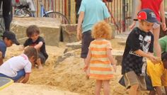 like the hard scape rocks in the sand area  http://www.greenschoolyards.org