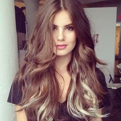 Loose waves and blonde peek-a-boo highlights