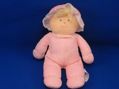 I am looking for a Eden doll with a pink sleeper and white bonnet, with yellow yarn hair and ball like hands and feet.