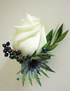 English roses and Scottish thistles with viburnum tinus berries...great boutonniere