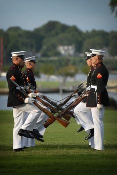 Members of the U.S. Marine Corps Silent Drill team perform at the U.S. Naval Academy for the Class of 2015. Members of the Silent Drill Platoon are hand picked to represent the Marine Corps.