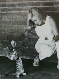 0 Yvette Mimieux playing with a puppy