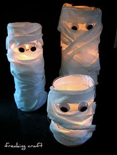Mummy candles.... gauze wraps, glass candle holders and googly eyes