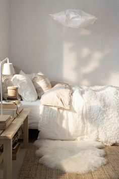 cozy bed in earthy, monochromatic bedroom