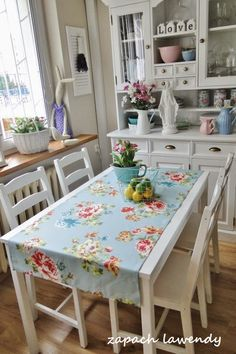 Shabby Chic Dining Room with Blue Runner, Pink Roses on White Table, with White Built in Buffet with Vintage Items