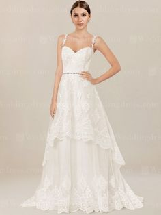 Lace wedding dress features sweetheart bodice with beautiful lace straps for support.
