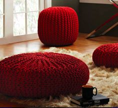 love how the deep red ottoman goes with the beige carpet. Also love the perfect clash of textures between shaggy and crochet.
