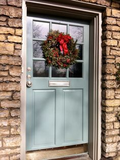 Mark's festive door in Castle Gray, trim in Hardwick White.