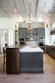 Love the island design of painted cabinet and stained wood. The best of both worlds. Becki Owens - Blog