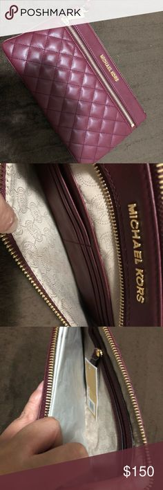 Michael Kors Large Quilted Selma Wristlet NWT never been used. Purchased it because I wanted a wristlet but didn't know it would be massive in size. The wristlet is in the color maroon. Last photo taken is a size comparison of the wristlet and my coach wallet for reference. Wristlet has 6 card slots, 2 side pockets, and 1 interior zip pocket. Michael Kors Bags Clutches & Wristlets