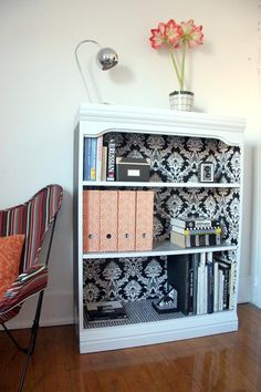 Wallpaper on the inside of a bookshelf. Fun way to add color to a room! USE THIS FOR BEDROOM SHELF. -reminder: like the molding on top and wallpaper idea to add splash of color.