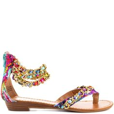 Accessorize your ensemble with the Mindy by ZiGi. This multi color sandal brings you a sexy look with the sleek chain link straps that will hang flawlessly around your ankle. A zipper in the back will make it easy to slip this pretty style on.