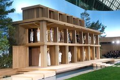 No expense spared:Models emerged from a supersized wooden box-like doll house with three levels before walking through the large open space, covered in fake grass and lined with timber walkways and steps