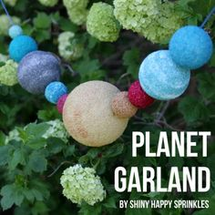 Here's an idea for child's Outer Space party -- a garland of planets. Tutorial from One Charming Party.  onecharmingparty.com #outerspaceparty