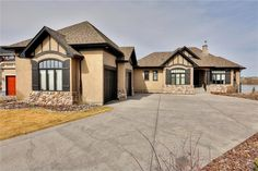 Amazing views of the lake, wetlands & mountains from this custom-built walkout bungalow. The main floor has views from almost every room, with extensive hardwood & title flooring, family room with fir