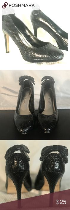 White House Black Market Genuine Snake Bow Backed Beautiful Black Snake Skin Pumps by White House/Black Market Pumps. Worn Once and were so comfortable and glamorous. Perfect for black tie affairs to add a a flair of edge. Or with jeans and a tee to class up your outfit. A tiny bit of scale lifting on back Bow and side. Unnoticeable when worn. Please ask questions before buying if your concerned. White House Black Market Shoes Heels