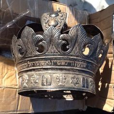 An antique Jewish silver crown decorated with Hebrew inscriptions and the Star of David, part of religious ceremonies artifacts that were recovered by Egyptian authorities