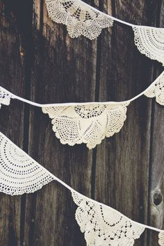 Half 1/2 doilie, doilies sewn to create bunting garland for wedding reception or home decor; Upcycle, Recycle, Salvage, diy, thrift, flea, repurpose, refashion! For vintage ideas and goods shop at Estate ReSale & ReDesign, Bonita Springs, FL