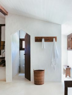 white_bathroom, wood accents, and that awesome door