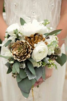 The seeded eucalyptus and white waxflower along with the gold touches is beautiful. I would substitut e the roses with lilies or mums maybe. .. hmm
