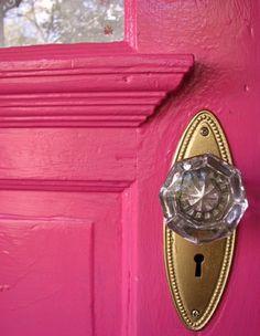 pink door and glass doorknob