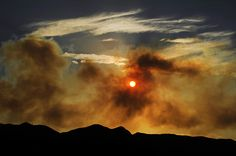 The sun sets west of Briargate in Colorado Springs. The Waldo Canyon fire continues to burn northwest of Manitou Springs, Colorado today June 25th,2012. Helen H. Richardson, The Denver Post