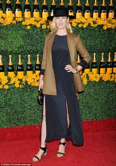 Hold your horses! January Jones was spot on in her polka dot navy dress when she attended ...