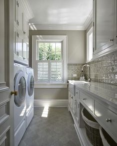 Made in heaven: Laundry today, or naked tomorrow - take out cabinets above w/d and add 2nd dryer!
