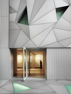 #Architecture  I like the different triangles used to create that 3D affect rather then having the wall flat , its almost like a jigsaw with missing pieces