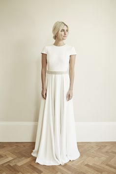Charlotte Simpson simple modern wedding dress with full skirt and embroidered beaded belt