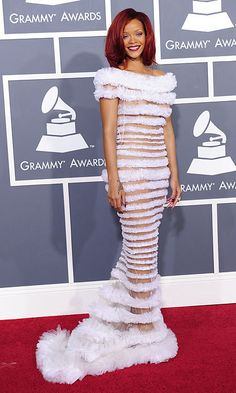 Rihanna wearing a Jean Paul Gaultier that evoked some kind of ethereal sea creature! The singer chose a striped white gown with sheer panels and completed her look with heels by Christian Louboutin.