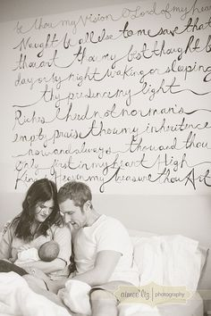 Lyrics as a mural. She hand drew them then projected them and used black paint pens on white wall. Love.