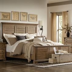 Beautiful master bedroom in varying shades of white and other neutrals.  Love the headboard design in this amazing bed!