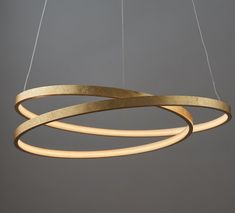 An LED ceiling pendant finished in a gold leaf effect. Formed from a twisted design which gives the optical illusion of being 2 rings. Ring Chandelier, Wagon Wheel Chandelier, Sputnik Chandelier, Pendant Lighting, Chandelier Bedroom, Gold Ceiling, Ceiling Lights, Swarovski, Lumiere Led