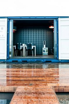 The lounge container is setup like a breakfast nook for guests to enjoy a cup of coffee or...