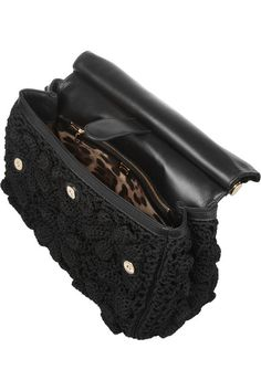 Black crochet, black leather (Lamb) Top handle, detachable shoulder strap Designer plaque, feet, gold hardware Internal pouch and zipped pockets, internal snap-fastening tab Fully lined in leopard-print twill Snap-fastening front flap Comes with dust bag
