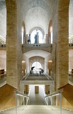 Les Aigues Library, a respectful renovation of a former urban water deposit in Barcelona. Stairs Architecture, Architecture Design, Beautiful Library, Adaptive Reuse, Hotel Interiors, Brick Building, Brickwork, Barcelona, House Styles