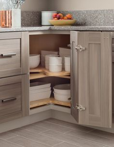 Say goodbye to wasted cabinet space! A lazy Susan positioned in the hard-to-reach corner space makes it easy to store and retrieve servingware. Visit your nearest @homedepot and start planning your kitchen makeover!