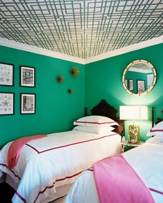 The ceiling is very nice.   Preppy Chic -  Pink and green get the Hollywood Regency treatment in this guest bedroom, where the color motif is highlighted on the sheets and even on the ceiling.