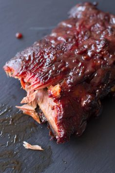 BBQ Ribs Tender and delicious, these saucy Smoked BBQ Ribs are pure perfection and fall off the bone. Step by step instructions on how to smoke ribs using the 321 and 221 method. Smoker Recipes, Grilling Recipes, Pork Recipes, Slow Cooker Recipes, Chicken Recipes, Cheese Recipes, Vegan Recipes, Delicious Recipes, Cake Recipes