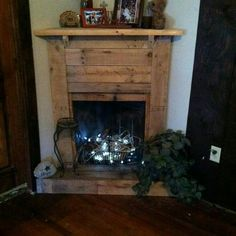 She made this faux fireplace and mantle out of pallet wood...it ...