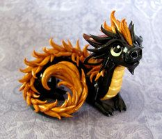 This little guy is a Dragons and Beasties product. The woman who made him sells the dragons on www.etsy.com. They are barely ever there but I still love them!